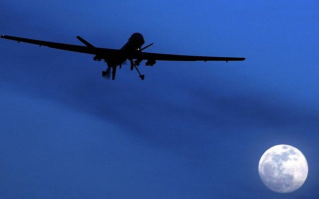 File: An unmanned US Predator drone flies over Kandahar Air Field, southern Afghanistan, on a moon-lit night, on January 31, 2010. (AP Photo/Kirsty Wigglesworth, File)