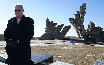 Nazi hunter Efraim Zuroff saying Kaddish, a mourning prayer, for Holocaust victims near Kaunas, Lithuania, Feb. 15, 2015. (Cnaan Liphshiz/JTA)