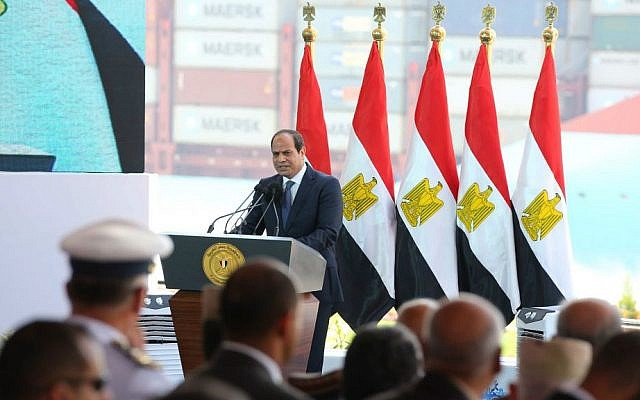Egyptian President Abdel-Fattah el-Sissi marks the first anniversary of the inauguration of an expansion of the Suez Canal, in Suez, Egypt, Saturday, August 6, 2016. (MENA, Egypt's state news agency, via AP)
