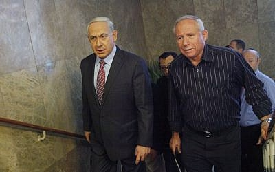 Prime Minister Benjamin Netanyahu (left) and Likud MK Avi Dichter (right), former head of the Shin Bet, in 2016 (Miriam Alster/FLASH90)