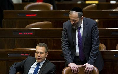 Public Security MInister Gilad Erdan, left, speaks with then-Minister of Economy Aryeh Deri in the Knesset assembly hall, May 25, 2015, Jerusalem. (Yonatan Sindel/Flash90)