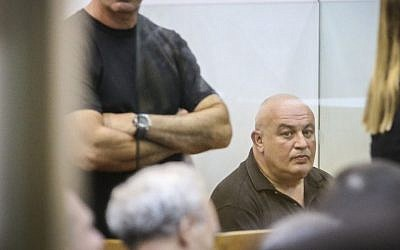 Former Likud party member of Knesset, Michael Gorlovsky, is brought to court after being arrested for alleged blackmail in a corruption affair with senior members of the Netivei Israel company, at the Rishon Letzion court, November 2, 2015. (Flash90)