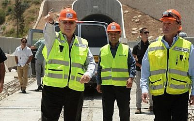 President Reuven Rivlin, left, takes a tour of the construction site for the new high-speed railway train being built between Jerusalem and Tel Aviv, on June 1, 2016. (Photo by Mark Neyman/GPO)