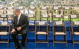 Prime Minister Benjamin Netanyahu waiting for government ministers to join him before a special cabinet meeting for Jerusalem Day in Jerusalem, June 2, 2016. (Marc Israel Sellem/Pool)