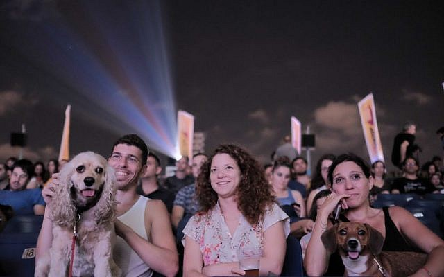 Israelis and their dogs attend a special rooftop screening of the movie 'The Secret Life of Pets' at the Azrieli Center in Tel Aviv on July 11,2016. (Photo by Tomer Neuberg/Flash90)