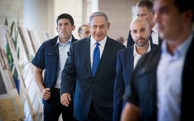 Prime Minister Benjamin Netanyahu arrives at a Likud faction meeting in the Knesset on August 1, 2016. (Miriam Alster/Flash90)