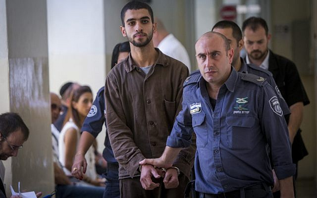 Ali Abu Hassan, a Palestinian student from a village outside of Hebron, walks through a Jerusalem court on August 2, 2016, before being indicted for attempting to carry out a terror attack on the Jerusalem light rail in July. (Yonatan Sindel/Flash90)