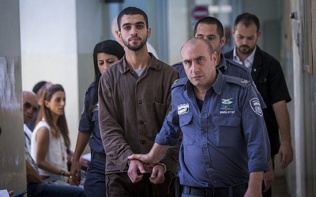 Ali Abu Hassan, a Palestinian student from Hebron who was arrested two weeks ago with explosives in his bag at a Jerusalem light station, is brought for a court hearing at the Jerusalem Magistrates Court on August 2, 2016. (Yonatan Sindel/Flash90)
