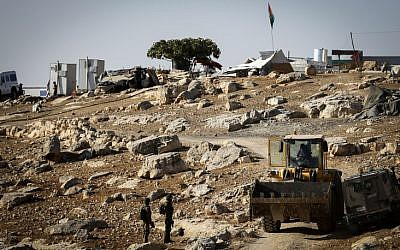 Israeli troops demolish 5 sheds in the West Bank village of Um Alkhair, south of Hebron on August 9, 2016. T(Wisam Hashlamoun/Flash90)