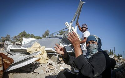 The Palestinian Hathaleen family seen at the ruins of their sheds demolished by Israeli troops in the West Bank village of Um Alkhair, south of Hebron on August 9, 2016. The sheds were demolished for the 9th time as Palestinians don't have the Israeli building permits required, near the settlement of Karmael. Photo by Wisam Hashlamoun/Flash90 *** Local Caption *** ???????? ????? ??? ?????? ????? ?????? ??? ????? ???? ??? ???? ?????? ??? ?????? ????? ???? ????? ????