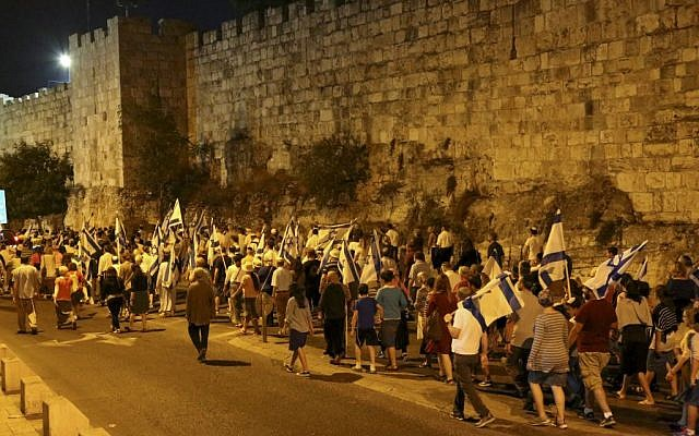 """A Tisha B'av march organized by """"Women in Green"""" around the walls of Jerusalem's Old City, calling for Israel to allow Jews on the Temple Mount, August 13, 2016. (Gershon Elinson/Flash90)"""
