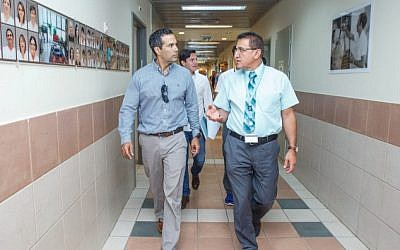 George P. Bush (L) walks as he visits with delegation of Businessmen from Texas at the Ziv Medical Center in Safed, Northern Israel, August 16, 2016. (Ziv Medical Center)