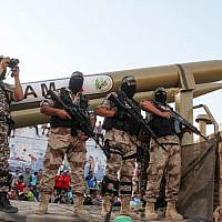 Palestinian members of the al-Qassam Brigades, the armed wing of the Hamas movement, display Qassam home-made rockets during an anti-Israel military parade on August 21, 2016 in Rafah in the southern Gaza Strip. (Abed Rahim Khatib/Flash90)