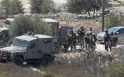 Israeli security forces at the scene where Iyad Hamad, a Palestinian man was shot dead by Israeli soldiers after running towards a guard post near the West Bank village of Silwad, August 26, 2016. (Flash90)