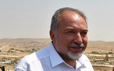 Defense Minister Avigdor Liberman tours Bedouin villages in the Negev, southern Israel, on August 29, 2016 (Ariel Hermoni/Defense Ministry)