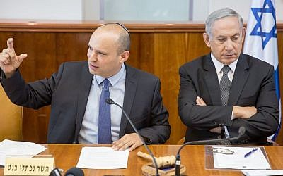 Prime Minister Benjamin Netanyahu, right, seen with Education Minister Naftali Bennett at the weekly cabinet meeting at the Prime Minister's Office in Jerusalem on August 30, 2016. (Emil Salman/Pool)