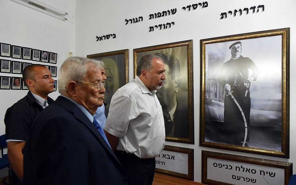Defense Minister Avigdor Liberman visits a branch of Yad leBanim, the association of the families of fallen IDF soldiers, in the Druze town of Daliyat al-Karmel on August 31, 2016. (Photo by Ariel Hermoni/Defense Ministry)
