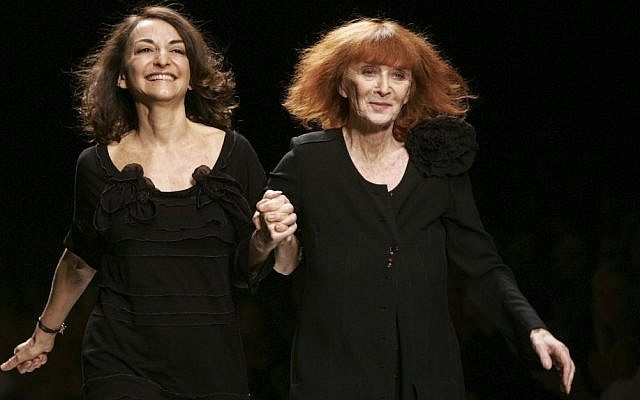 French fashion designers Sonia Rykiel, right, and her daughter Nathalie Rykiel acknowledge applause after the presentation of their Spring-summer 2007 ready-to-wear collection, in Paris, France, October 6, 2006. (AP Photo/Jacques Brinon)