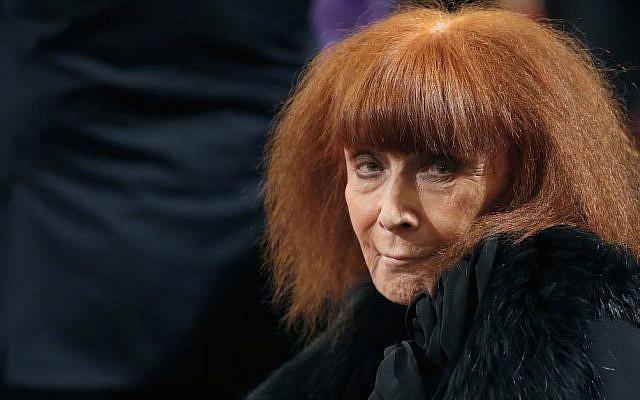 French fashion designer Sonia Rykiel attends a ceremony in Paris, France,  Novembe 26, 2013. (Christian Hartmann, Pool via AP)
