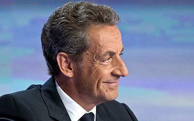 Former French president Nicolas Sarkozy speaks to  the media outside Paris on August 24, 2016. (AP Photo/Michel Euler)