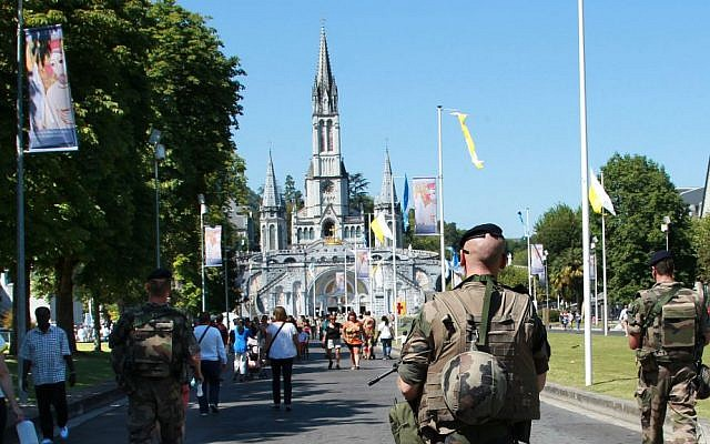 French soldiers patrol in the site of the sanctuary in Lourdes, southwestern France, Sunday Aug.14, 2016. (AP Photo/Bob Edme)
