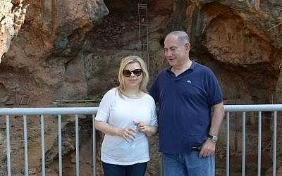 Prime Minister Benjamin Netanyahu and his wife Sara visit the Nahal Me'arot Nature Reserve, Northern Israel, on August 19, 2016. (Amos Ben Gershom/GPO)