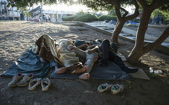 Migrants sleep in a park at the northern Greek city of Thessaloniki on Saturday, July 9, 2016. (AP Photo/Giannis Papanikos)