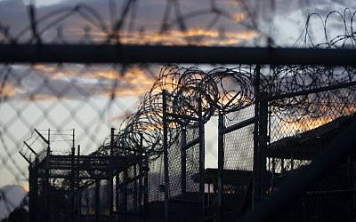 In this Nov. 21, 2013 file photo reviewed by the US military, dawn arrives at the now closed Camp X-Ray, which was used as the first detention facility for al-Qaeda and Taliban militants who were captured after the September 11 attacks, at the Guantanamo Bay Naval Base, Cuba. (AP/Charles Dharapak)