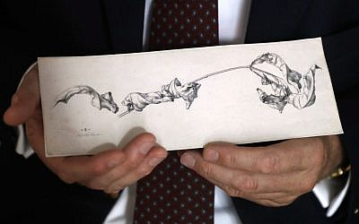 Dr. Johann Schiller holds a replica of a nearly 200-year-old drawing, Wednesday, Aug. 17, 2016, in Washington, after the original was returned to his family from the National Gallery of Art's collection decades after his relative was forced to sell it during World War II because of her Jewish heritage. 'A Branch with Shriveled Leaves' by the German artist Julius Schnorr von Carolsfeld had been owned by the artist's descendants until Dr. Marianne Schmidl sold it under duress in 1939. (AP/Jacquelyn Martin)