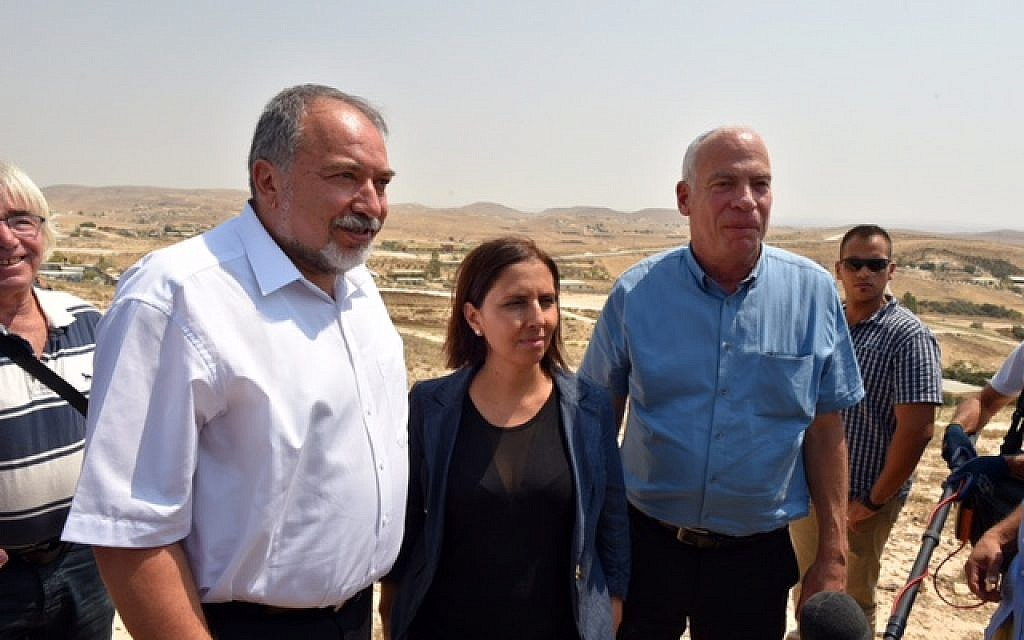 Defense Minister Avigdor Liberman, left, Minister of Social Equality Gila Gamliel and Agriculture Minister Uri Ariel speak to reporters following a tour of Israel's Bedouin communities in the Negev desert on August 29, 2016. (Ariel Hermoni/Defense Ministry)