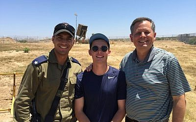 US Sen. Steve Daines stands with his son Michael in front of an Iron Dome missile defense battery just north of the Gaza Strip (Courtesy, Office of US Sen. Steve Daines)