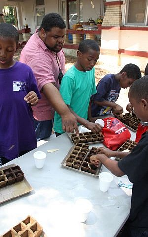 Michael Twitty teaching students to grow seedlings. (Jacob W. Dillow/ Courtesy)