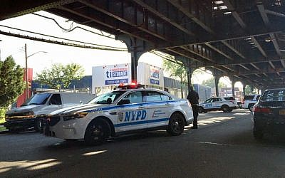File: New York City police secure a scene where two men were shot as they left prayers at a mosque in the Queens borough of New York, Saturday, Aug. 13, 2016. (AP Photo/Jennifer Peltz)