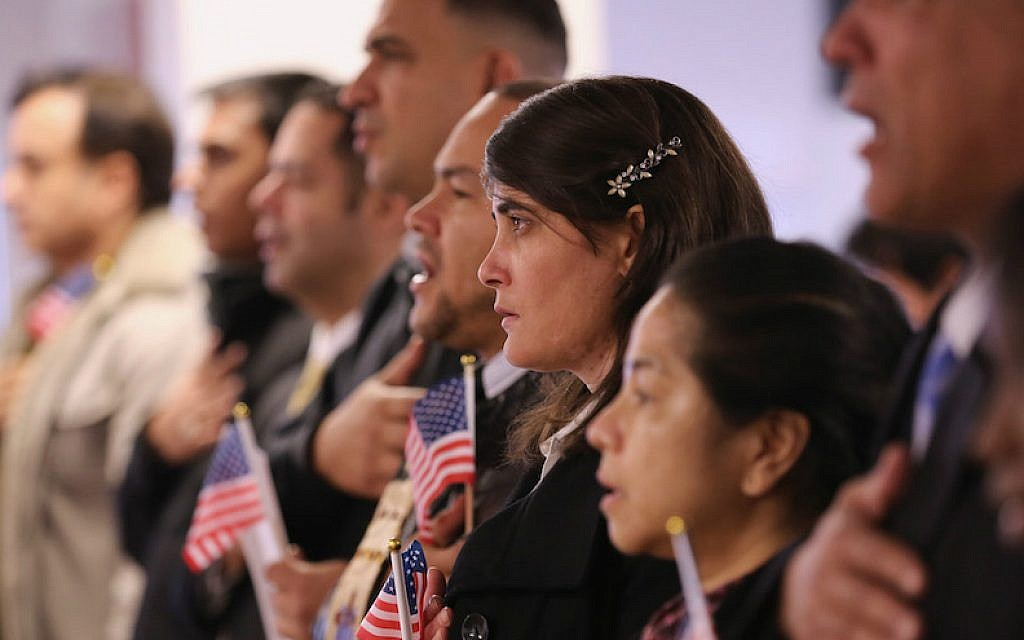 File: Immigrants taking their oath of US citizenship at the Federal Building in Newark, New Jersey, Nov. 20, 2014. (John Moore/Getty Images via JTA)