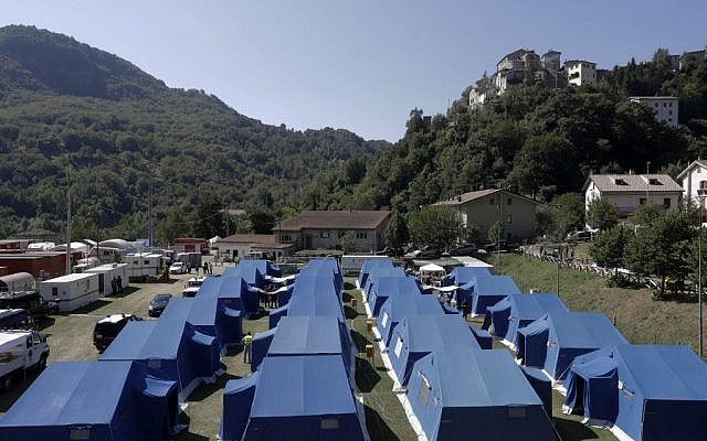 A view of a tent camp set as a temporary shelter for the earthquake survivors in Arquata Del Tronto, Italy, Sunday, August 28, 2016. (AP/Gregorio Borgia)