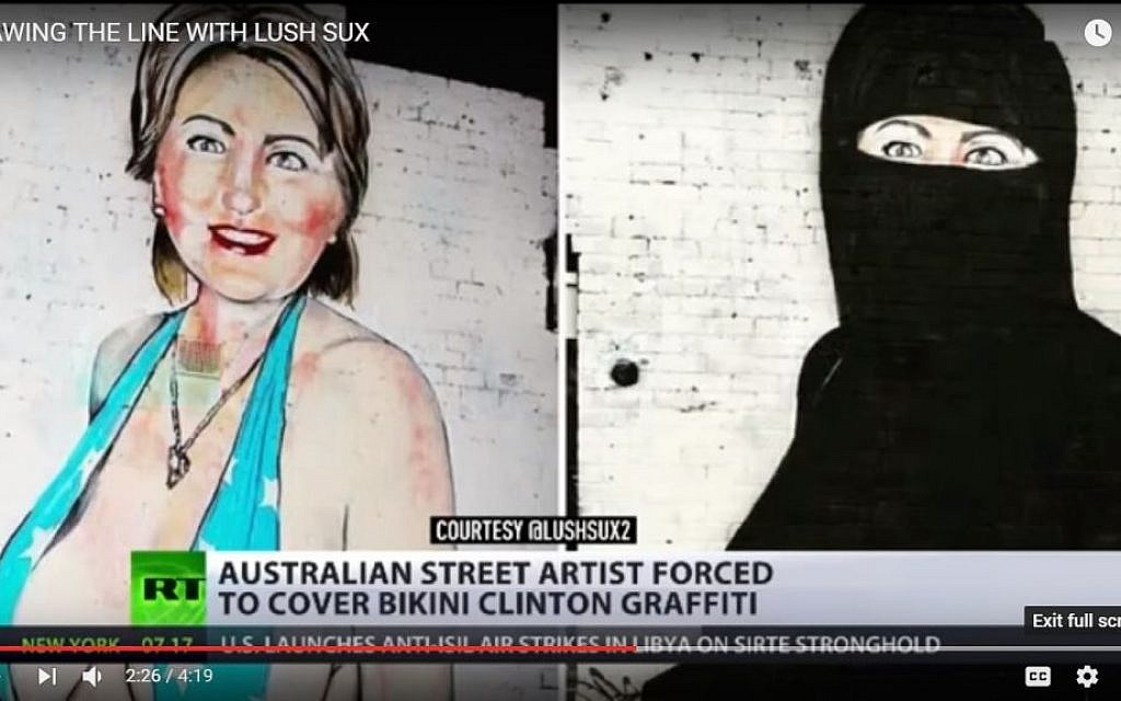 Hillary graffiti goes from bathing suit to niqab
