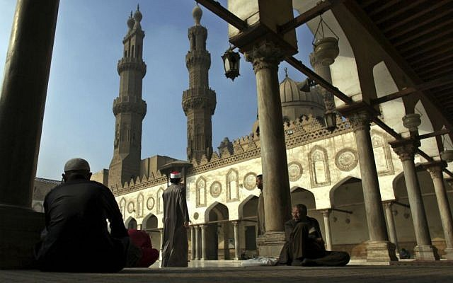 In this Dec. 28, 2012 file photo, Muslim men wait for the Friday noon prayer at Al-Azhar Mosque in Cairo, Egypt. (AP Photo/Khalil Hamra, File)