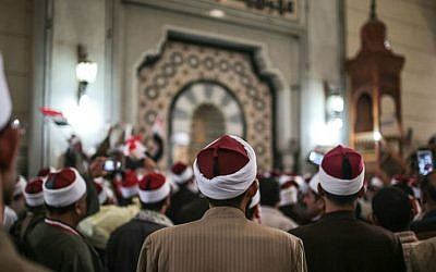 In this Feb. 3, 2015 file photo, Egyptian clerics from the Al-Azhar institution rally to denounce terrorism and show solidarity with the Egyptian government and security forces at a mosque in central Cairo, Egypt. (AP Photo/Mosa'ab Elshamy, File)