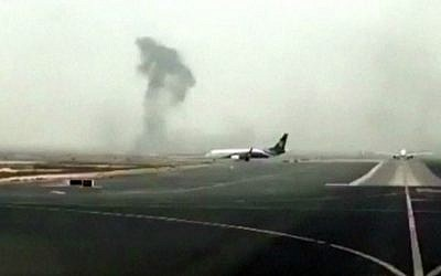 This image made from video shows smoke rising after an Emirates flight crash-landed at Dubai International Airport on Wednesday, Aug. 3, 2016. (Hayen Ayari via AP)
