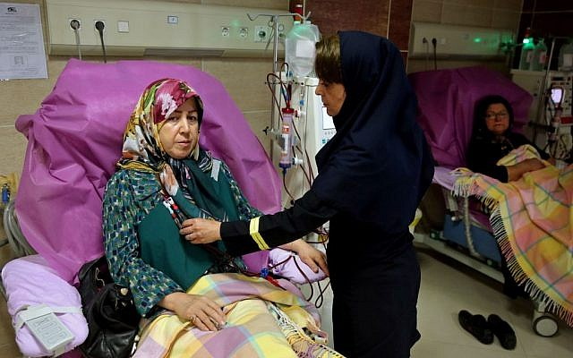 Zahra Hajikarimi uses a kidney dialysis machine as a nurse attends to her, at a clinic in downtown Tehran, Iran, August 6, 2016. (AP/Ebrahim Noroozi)