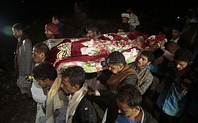 Mourners carry the body of Youssef al-Salmi, 10, who was killed when a bomb exploded while he was playing with it near his family's house in Hasn Faj Attan village, in the mountainous outskirts of Sanaa, Yemen, July, 24, 2016. (AP/Hani Mohammed)