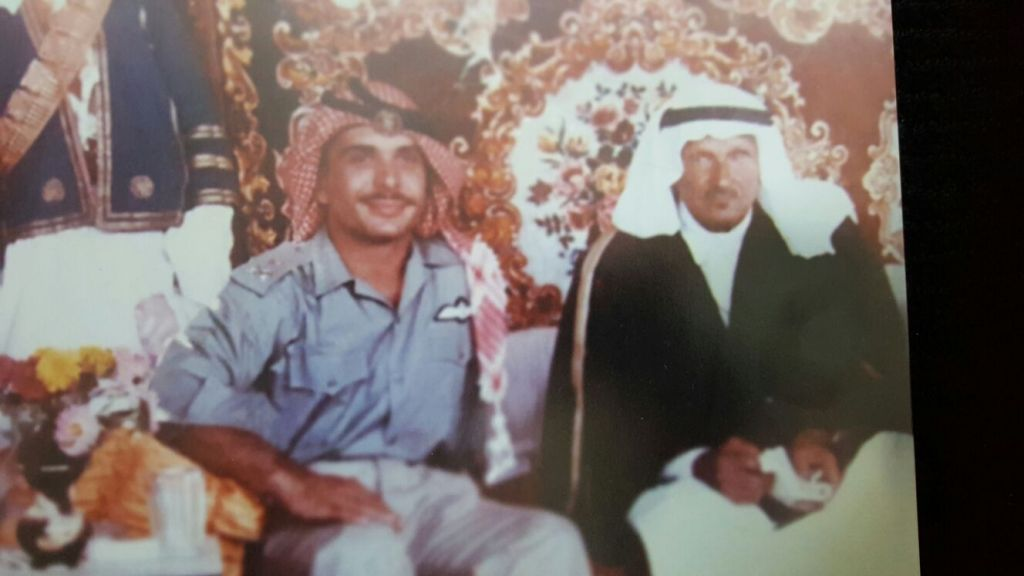 An image of King Hussein of Jordan sitting with Mithqal. The date and location are unknown. (Courtesy)