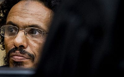Ahmad Al Faqi Al Mahdi waits in the courtroom for his initial appearance at the International Criminal Court in The Hague, Netherlands. September 30, 2015 (AP Photo/Robin van Lonkhuijsen, Pool, File)