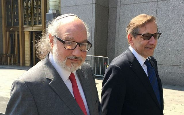 Jonathan Pollard (left), and his lawyer Eliot Lauer leave federal court in New York following a hearing, July 22, 2016. (AP/Larry Neumeister, File)