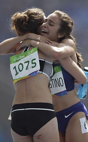New Zealand's Nikki Hamblin, left, and United States' Abbey D'Agostino after competing in a women's 5000-meter heat during the athletics competitions of the 2016 Summer Olympics, Rio de Janeiro, Brazil, August 16, 2016. (AP/David J. Phillip)