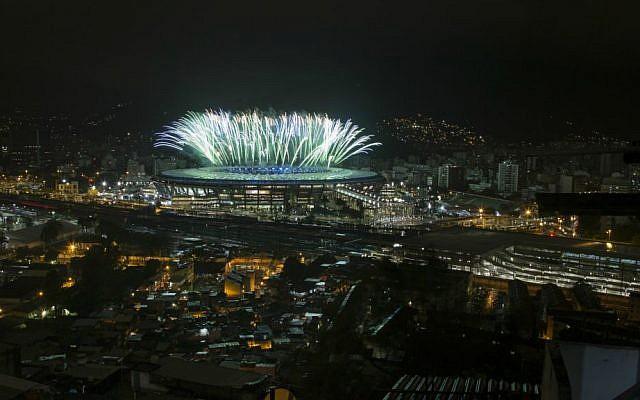 Fireworks explode above the Maracana stadium during the closing ceremony for the Summer Olympics, seen from the Mangueira slum in Rio de Janeiro, Brazil, Sunday, Aug. 21, 2016. (AP Photo/Felipe Dana)