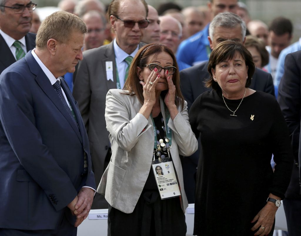 Ilana Romano, center, and Ankie Spitzer, right, widows of Israeli Olympic athletes killed by Palestinian gunmen at the 1972 Munich Olympics, attend a memorial in their husbands' honor, ahead of the Summer Olympics in Rio de Janeiro, Brazil, Wednesday, Aug. 3, 2016. The International Olympic Committee (IOC) held the memorial for the 11 Israelis who were killed. (AP Photo/Edgard Garrido, Pool)