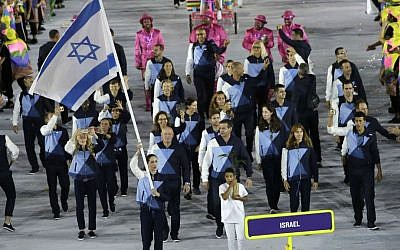 Neta Rivkin carries the flag of Israel during the opening ceremony for the 2016 Summer Olympics in Rio de Janeiro, Brazil, Friday, Aug. 5, 2016. (AP Photo/Matt Slocum)