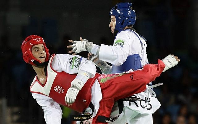 Ahmad Abughaush, of Jordan, left, battles Alexey Denisenko of Russia, in men's 68-kg taekwondo gold medal match at the 2016 Summer Olympics in Rio de Janeiro, Brazil, Thursday, August 18, 2016. (AP/Robert F. Bukaty)