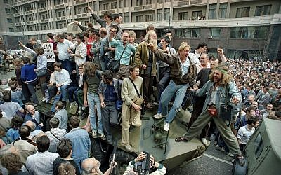 FILE - In this Aug. 19, 1991 file photo, crowds of people surround and climb on tanks which were stopped by the crowd as they drove towards the Red Square area of Moscow, Russia, during a military coup after the announced ousting of Mikhail Gorbachev from power. (AP/Boris Yurchenko, file)